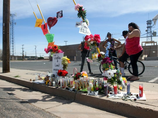 Friends visit the vigil site for Loreal Tsingine, who
