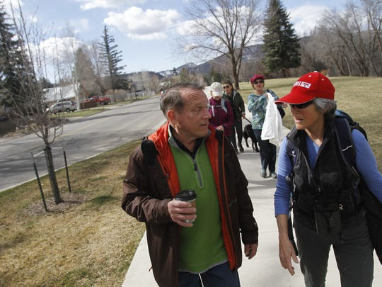 From left, Ken Oros and Lani Graham talk on March 25 as they participate in a walk along the Animas River in Durango, Colo. Blueprints of Hope organizes bimonthly walks along the river for cancer survivors, patients and caregivers.