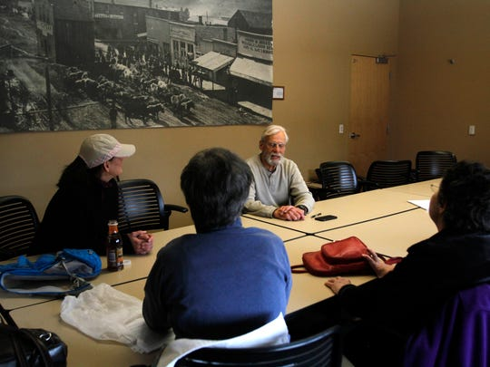 Louden Kiracofe, top right, talks on March 25 with members of a walking support group at the Durango Public Library in Durango, Colo. Blueprint of Hope, a Durango, Colo.-based nonprofit, organizes walks along the Animas River twice a week for cancer survivors, patients and caregivers.