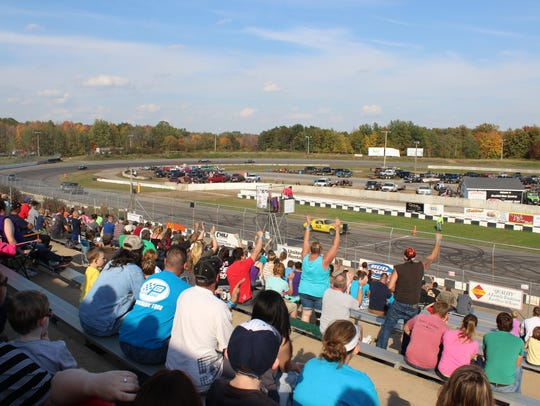 Fans cheer during a race at the Marshfield Motor Speedway.