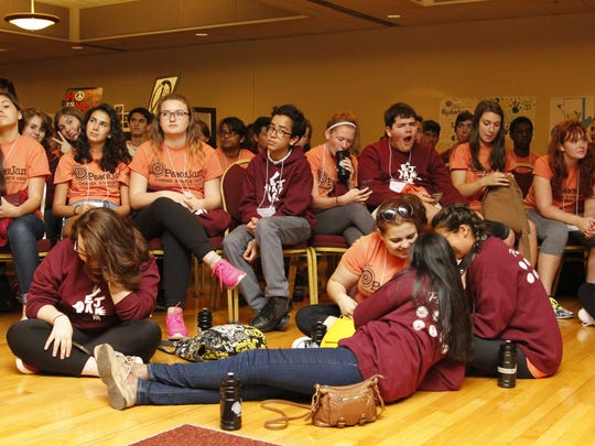 "Student participants, called ""Jammers,"" lounge during"