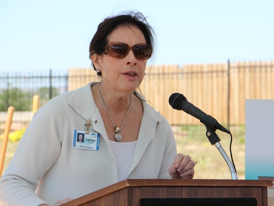 Carlsbad Medical Center CEO Cathy Hibbs speaks at the groundbreaking of an urgent care clinic.