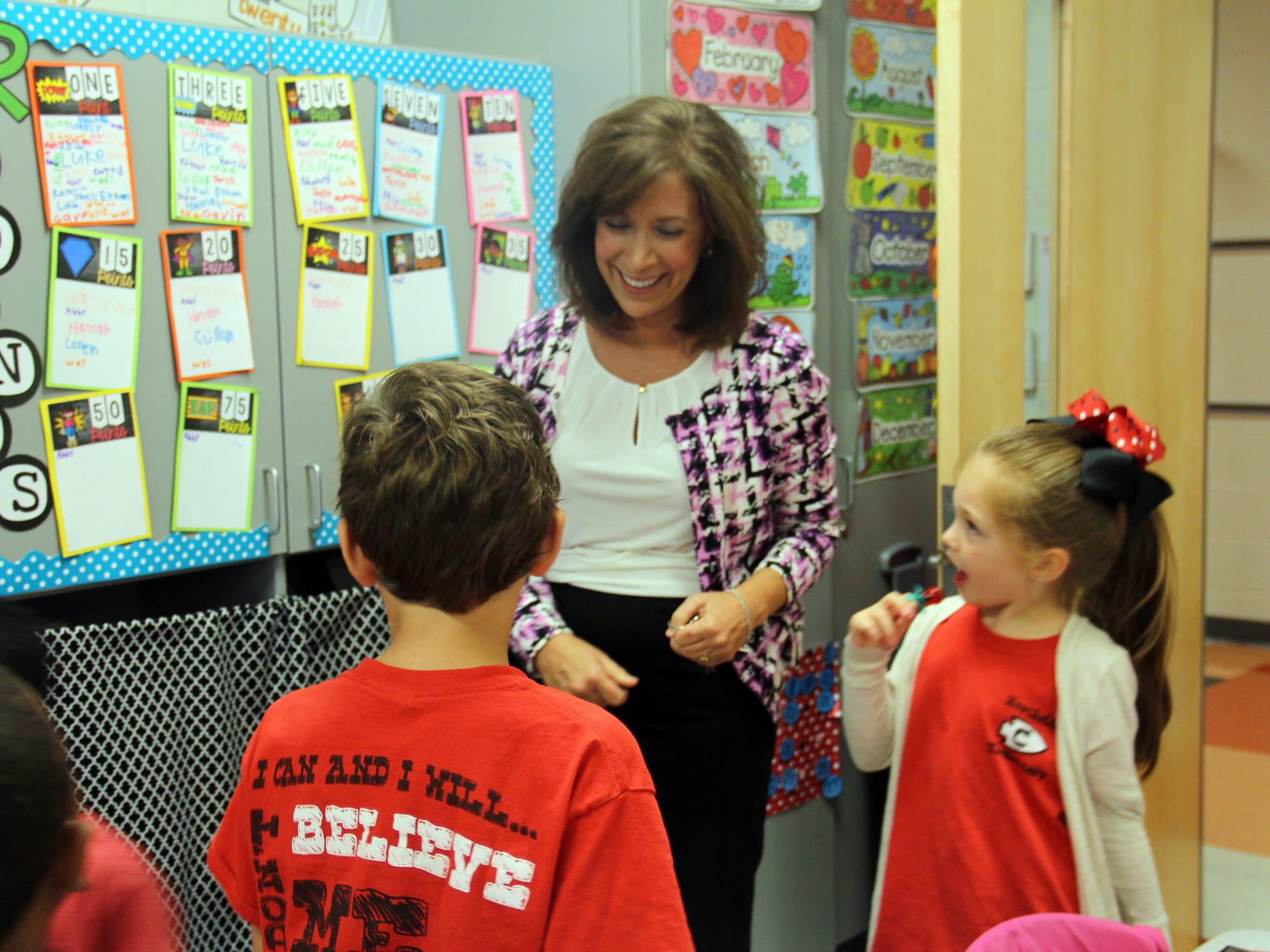 Joy Tyner, principal of Northside Elementary, visits a second-grade classroom.