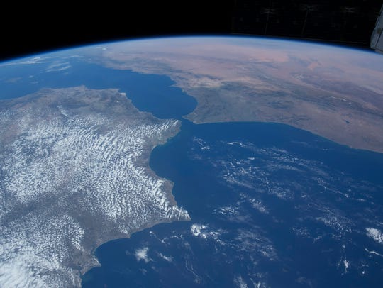 "An astronaut's perspective of the Strait of Gibraltar, Spain (left), the Mediterranean Sea and North Africa, from the International Space Station, as seen in ""A Beautiful Planet."" Knoxville's latitude - 35.9606 N - passes through the narrow strait."