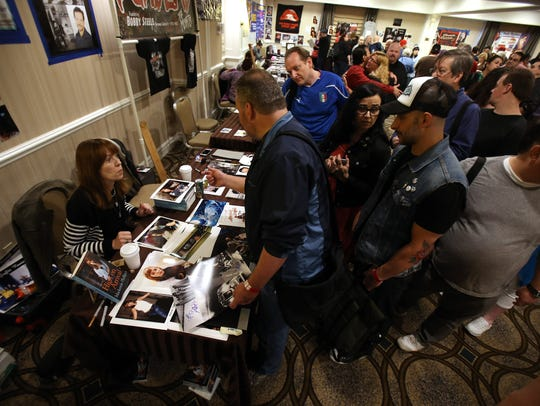 Mackenzie Phillips signs autographs for fans during