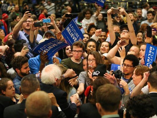 Democratic presidential candidate Bernie Sanders shakes