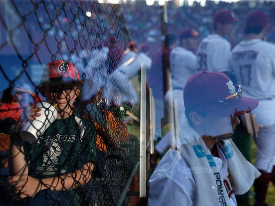 In a double exposure image, FSU fans and players each watch the game from their respective seats during their game against Notre Dame at Dick Howser Stadium on Saturday.