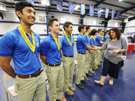 Cathedral High School teacher Mary Alice Shashy congratulated