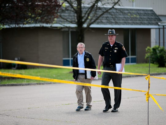 Ohio Attorney General Mike DeWine and Pike County Sheriff Charles Reader arrive at a 3:00 pm press conference to deliver an update on the Rhoden murders at the makeshift command center in Waverly, Ohio, on Wednesday, April 27, 2016.
