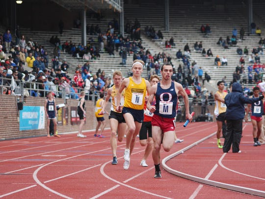 Salesianum's Andrew Hally runs his 1,600-meter anchor leg during the distance medley relay at Franklin Field.