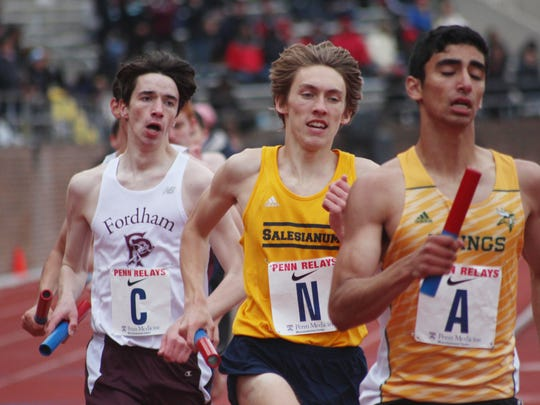 Salesianum's George Steinhoff churns out his 800-meter leg in the distance medley relay.
