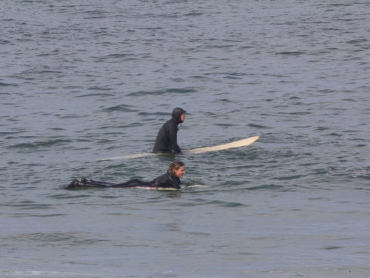 A couple surfers carved the waves north of Manasquan Inlet Monday afternoon.