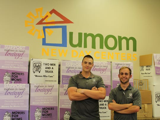 The two men from Two Men and a Truck just finished unloading all of the essential-care item packages for UMOM mothers.