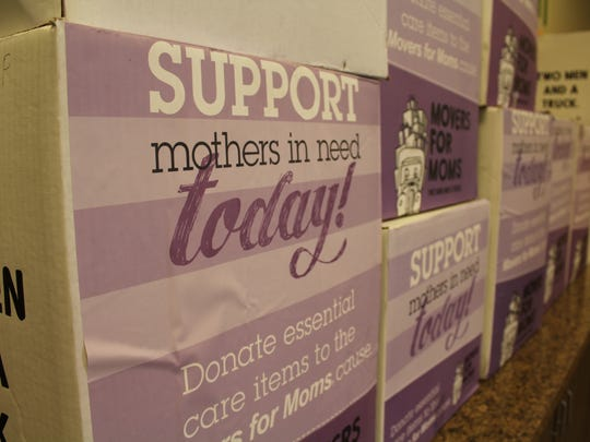 Boxes filled with shampoo, soap and other beauty products for the mothers of UMOM.