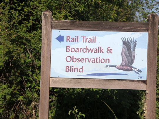 A sign marks the trailhead for Rail Trail at Ankeny National Wildlife Refuge.