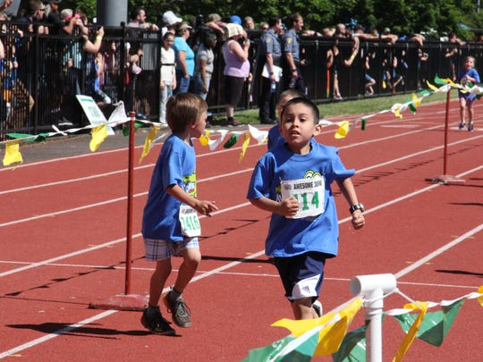 Xavi Ceja finishes the run for first grade boys at the Awesome 3000 event on Saturday, May 7, 2016 in Salem.