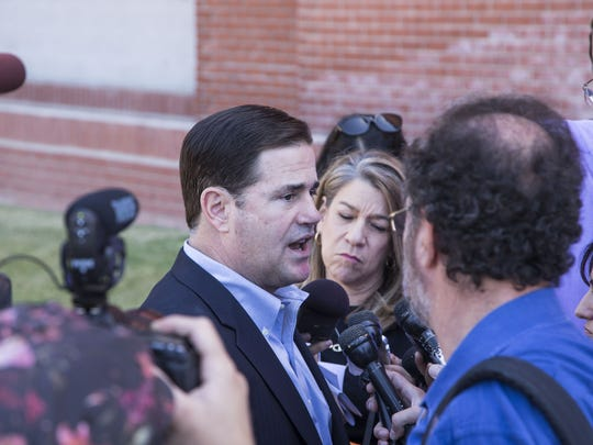 Arizona Gov. Doug Ducey takes questions from reporters