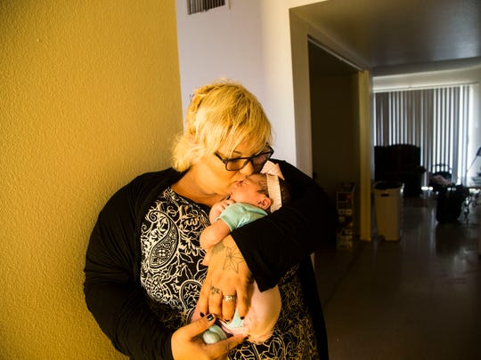 Other transitional-housing agencies in Mesa and Phoenix face similar crises, given waiting lists reported at affordable-housing complexes. Mandi Boyster, with her 5-day-old baby girl ,Shyloe, lives in one of the units at House of Refuge in East Mesa.