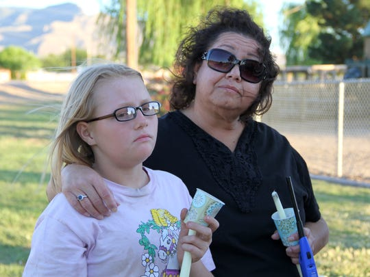 Dorris Valdespino and her 11-year-old granddaughter Eva Beidelman remembered the life of Ashlynne Mike at a vigil at Kids Kingdom Playground Tuesday evening.