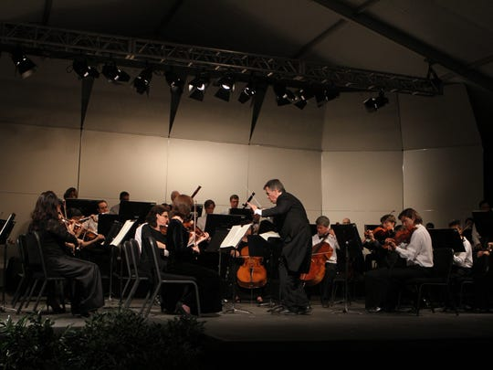 Maestro Joel Revzen leading the Classical Tahoe Orchestra.