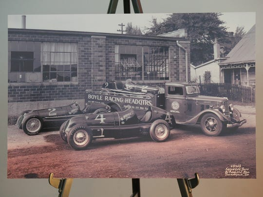 Original photo of the now fully restored Boyle race car hauler in front of the Boyle Racing headquarters.