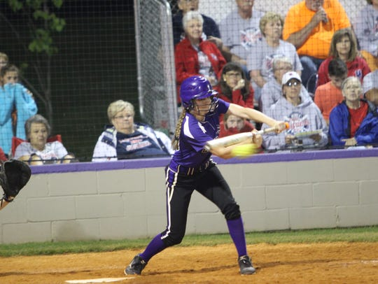 A Clarksville High batter tries to lay down a bunt
