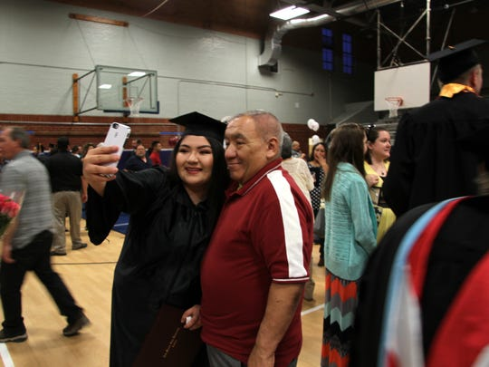 Stephanie Medina posed for a selfie with her father, Felix Medina, after the graduation ceremony on Friday.