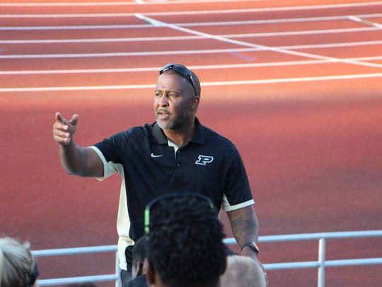 Purdue track and field coach Lonnie Greene speaks to