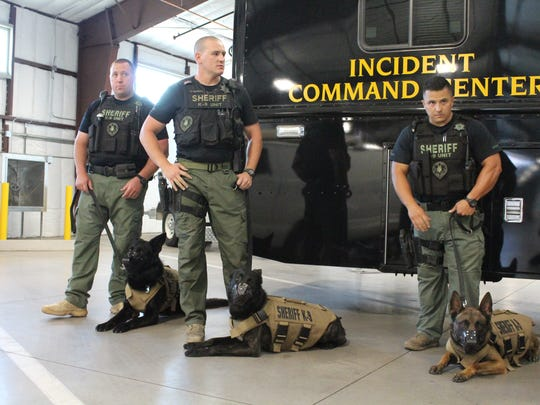 Maricopa County sheriff's K-9 officers, shown with their handlers, now all have bulletproof vests. Photo taken May 18, 2016.