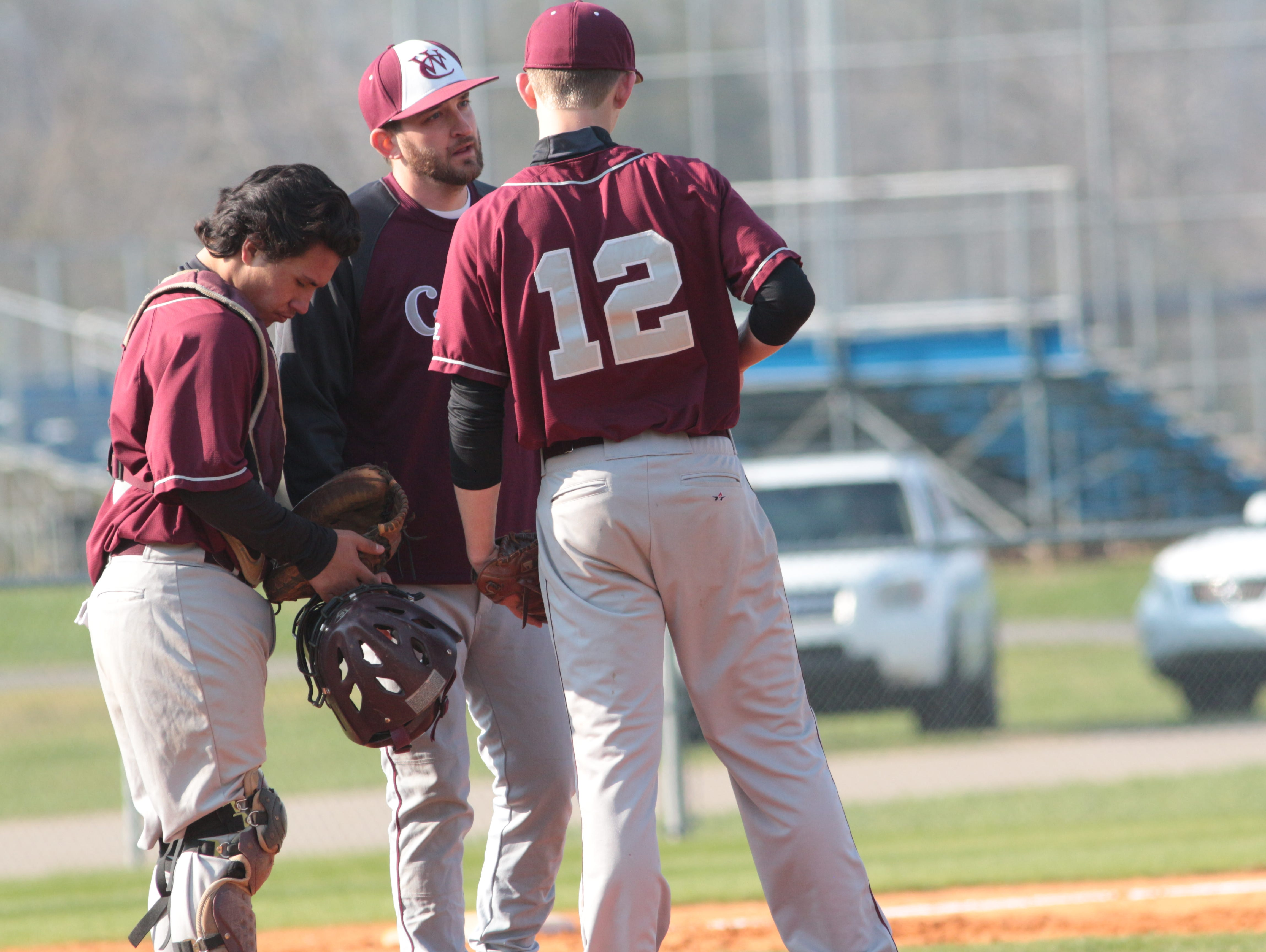 West Creek coach Will Jobe talks to his pitcher and catcher during a game earlier this season. Jobe resigned Wednesday at the Coyotes' baseball coach.