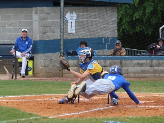 Clarksville Academy catcher Robbie Yates tries to tag
