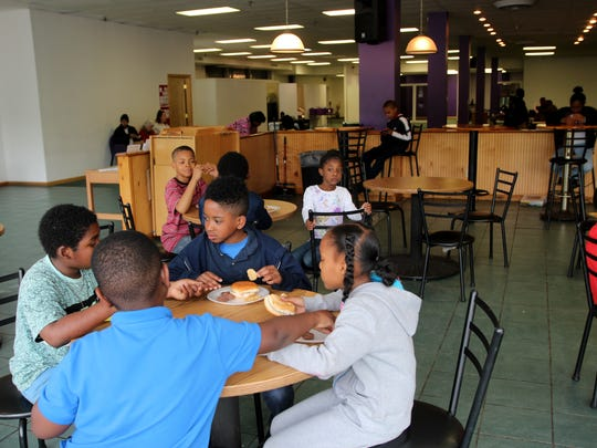 At New Level Sports, children take a break from writing