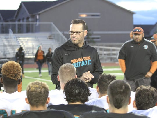 Pebble Hills head coach Mark Torres talks to the team after a spring football game at home.