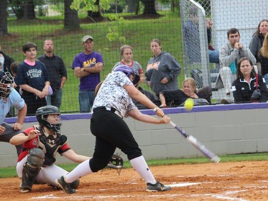 Clarksville's Peyton Wilson tries to swing around on