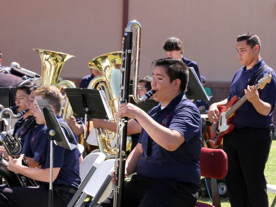 The state champion Deming High School Band provided