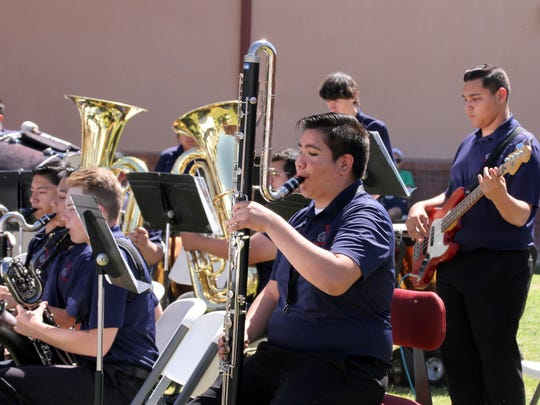 The state champion Deming High School Band provided rousing entertainment, including a medley of U.S. Armed Forces songs.