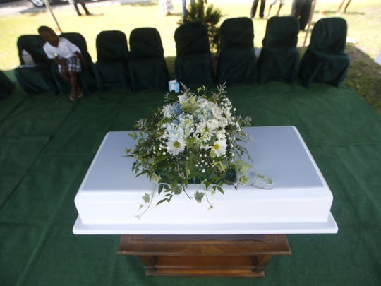 A small casket for for 10-month-old Jeffery Lamar Phillips III rests at the Southside Cemetary will the infant will be laid to rest on Saturday, May 21, 2016.