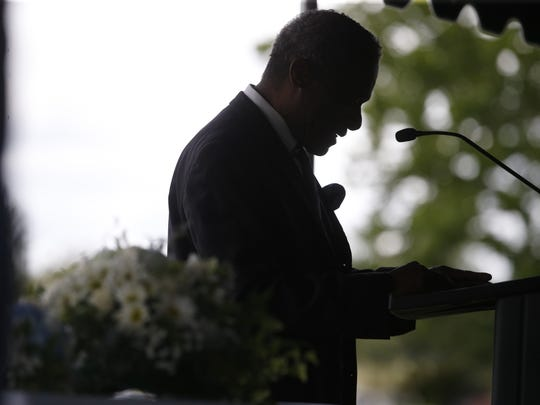 Rodney Landers gives a 'going home testimonial' during the funeral for 10-month-old Jeffery Lamar Phillips III, at the Southside Cemetary where the infant will be laid to rest on Saturday, May 21, 2016.