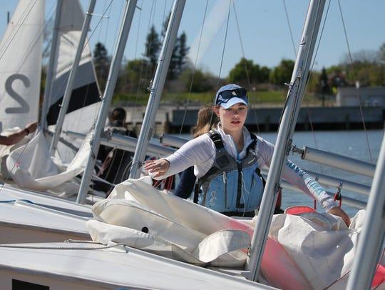 Ashley McDonald, 17, W. Irondequoit, attaches her sail