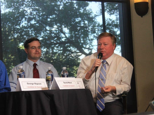 Brian Wursten, right,  shares his opinion on the potential impact on the area's golf industry if the Virgin Valley Water District were to raise rates.