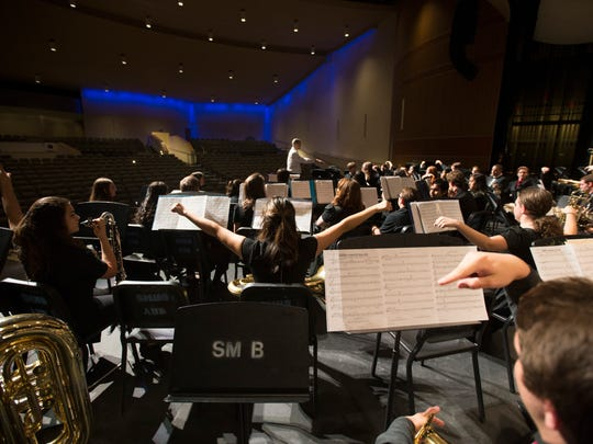 Shadow Mountain's band practices before a fundraising show at Shadow Mountain High School on May 9, 2016 in Phoenix, Ariz. The Shadow Mountain High School band has been invited to perform for the 75th anniversary of Pearl Harbor, representing Arizona and the USS Arizona. But getting the 60-member band to Hawaii would be complicated.
