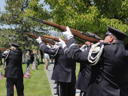 A rifle squad fires during the Memorial Day remembrance