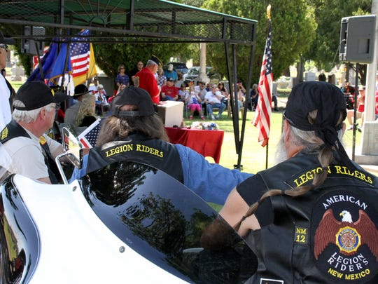Members of the American Legion Riders, Chapter 12, listen in during Monday's Memorial Day cermeony at Mountain View Cemetery.