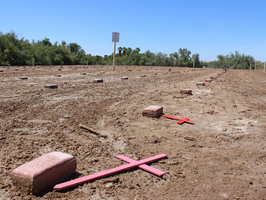 Fallen crosses mark the graves of unidentified and unclaimed bodies in a Potter's Field behind Terrace Park Cemetery in Holtville. Many of the migrants who die crossing the border in Imperial County end up here.