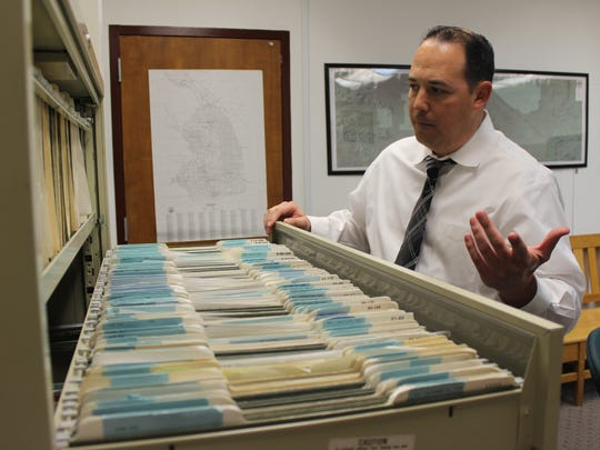 Sgt. Eric Frazier, who heads the Imperial County Coroner's Office, opens a filing cabinet filled with John/Jane Doe cases. About 450 unidentified bodies have been found in Imperial County since 1990, and about 90 percent are believed to be border crossers.