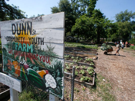 Volunteers work at the IGrow farm, a local community garden, on Dunn Street in Frenchtown.
