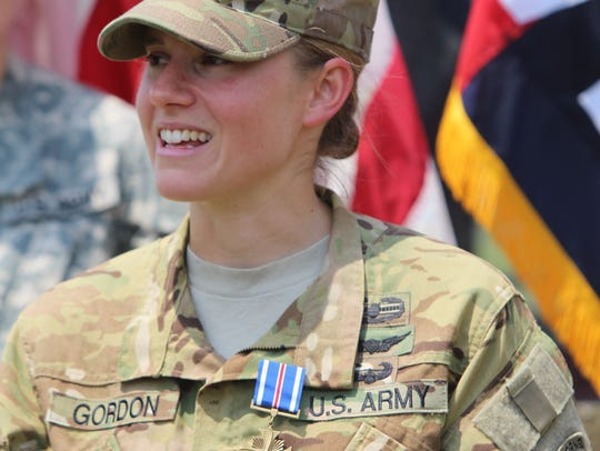 Capt. Lindsay Gordon smiles after receiving the Distinguished