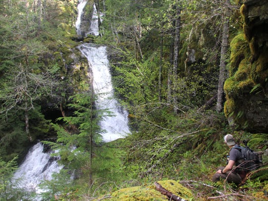 Salem photographer Jeff Green looks to navigate around Don and Dave Falls in the Family Falls system of waterfalls on upper Henline Creek.