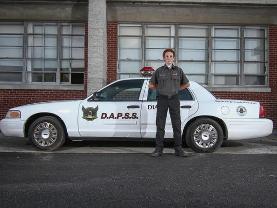 D.A.P.S.S. student Joshua Ritter (14) pose for a photo in front of a D.A.P.S.S emergency services vehicle Wednesday, June. 1, 2016 on the campus of Delaware Academy of Public Safety and Security in New Castle.