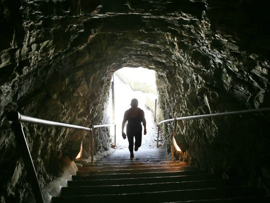 Reporter Victoria Freile heads up through the entrance tunnel leading into Watkins Glen State Park in Watkins Glen in this 2016 file photo. Tunnels in the gorge were hand-cut into the rock in the early 1900s.